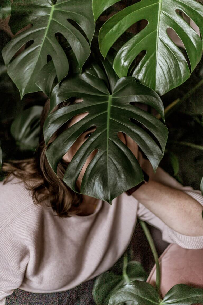 Aime hiding behind a plant. She's a proper businesswoman we promise.