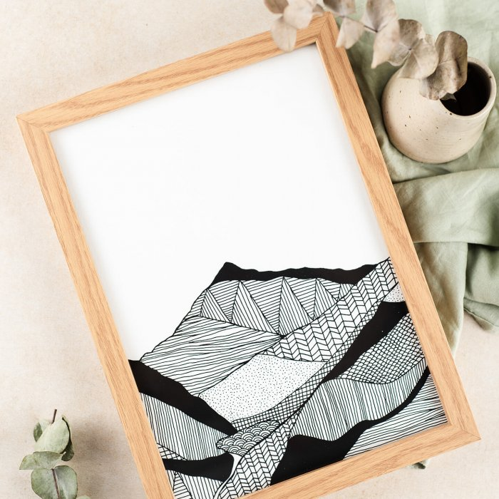 Carissa Tanton angled view of mountain art and frame by Studio Cotton