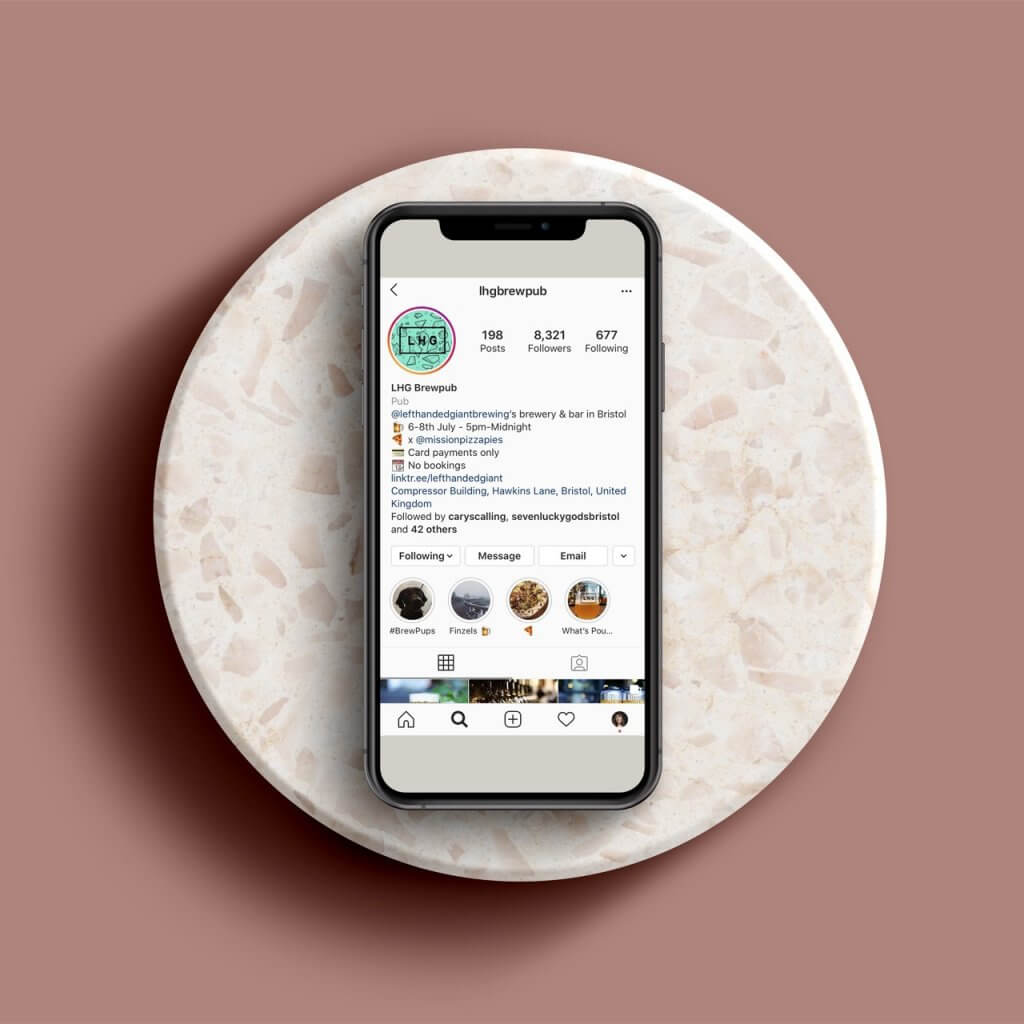 Instagram bio hone screen on phone resting on marble circle plate