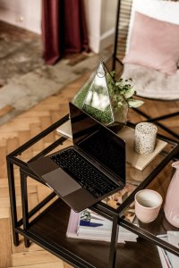 Laptop on a coffee table featuring a sexy parquet floor